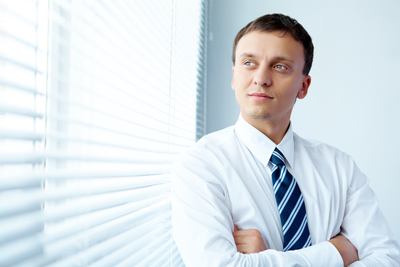 young-businessman-by-the-window